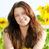 Beautiful woman in a sunflower field Royalty Free Stock Photography