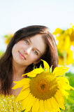 Beautiful woman in a sunflower field Royalty Free Stock Photos
