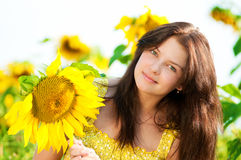 Beautiful woman in a sunflower field Stock Photo