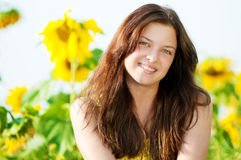 Beautiful woman in a sunflower field Royalty Free Stock Image