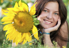 Beautiful woman in a sunflower field Stock Photography
