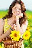 Beautiful woman in a sunflower field Stock Photos