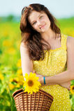 Beautiful woman in a sunflower field Royalty Free Stock Images