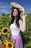 Beautiful woman in sunflower field Stock Photo