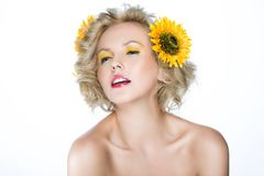 Beautiful woman with sunflower flowers in her hair Stock Images
