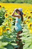 Beautiful woman with sunflower Stock Photography