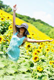 Beautiful woman with sunflower Stock Image