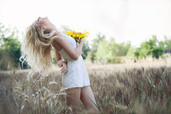 Beautiful woman between sunflower Stock Images