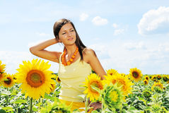 Beautiful woman and sunflowers. Beautiful young woman among the sunflowers Stock Photos