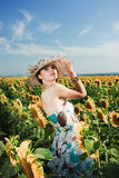Woman in field with sunflowers Stock Photo