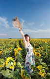 Woman in field with sunflowers Stock Images
