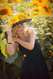 Beautiful woman between sunflowers Royalty Free Stock Image