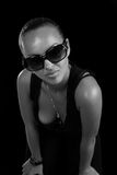 Beautiful woman in sunglasses. Background black ( black white Stock Image