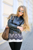Beautiful woman in sunglasses. Portrait of young beautiful woman in sunglasses wearing black jacket stock image