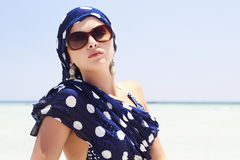 Beautiful woman in sunglasses on beach. arabian style Royalty Free Stock Images