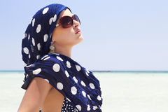 Beautiful woman in sunglasses on beach. arabic style Stock Photo