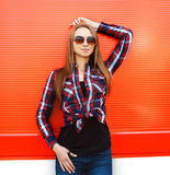 Beautiful woman in sunglasses and checkered shirt Stock Photo