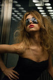 Beautiful woman in sunglasses in elevator Royalty Free Stock Image