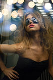 Beautiful woman in sunglasses in elevator Royalty Free Stock Photos