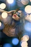 Beautiful woman in sunglasses in elevator stock image