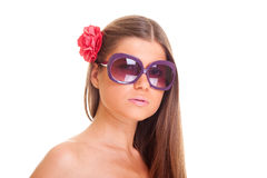 Beautiful woman in sunglasses with flower Stock Photography