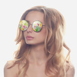 Beautiful woman in sunglasses with flowers Royalty Free Stock Photography
