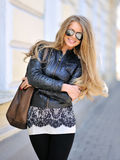 Beautiful woman in sunglasses with handbag Stock Images