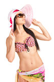 Beautiful woman in sunglasses and hat Stock Photography