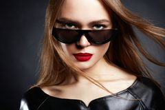Beautiful Woman in Sunglasses and Leather Royalty Free Stock Photo