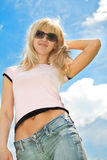 Beautiful woman with sunglasses over blue sky Royalty Free Stock Photo