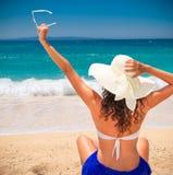 Beautiful woman in sunhat  enjoying on beach. Stock Photography