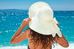 Beautiful woman in sunhat looking view of beach stock photo