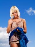 Beautiful woman on the sunny blue sky stock photos