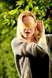 Beautiful woman in the sunny forest, covered her face with hair,. Fooled Stock Photos