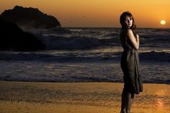 Beautiful woman at sunset. A beautiful girl at the ocean during sunset Royalty Free Stock Images