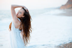Beautiful woman at sunset Royalty Free Stock Photography