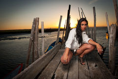 Beautiful woman at sunset at the harbor Royalty Free Stock Images