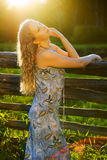 Beautiful woman by the sunset light Stock Photography