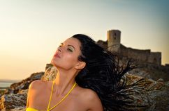Beautiful woman at sunset/sunrise Royalty Free Stock Images