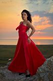 Beautiful woman at sunset/sunrise Royalty Free Stock Photos