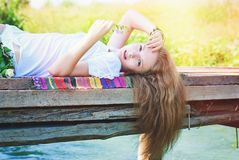 Beautiful Woman in Sunshine Outdoors. Beauty and Fashion royalty free stock photo
