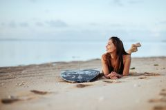Beautiful woman with the surf board royalty free stock image