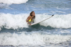 Beautiful woman on surfboard Royalty Free Stock Photography