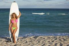 Beautiful woman on surfboard Stock Image