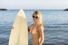 Beautiful woman with the surfboard Stock Photo