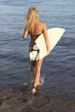 Beautiful woman with the surfboard Stock Photography