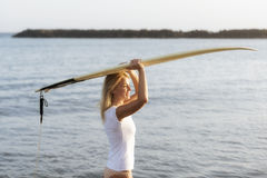 Beautiful woman with the surfboard Stock Photos