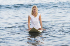 Beautiful woman with the surfboard Stock Images