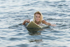 Beautiful woman with the surfboard Stock Image