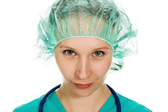 Beautiful woman surgeon angrily looks Stock Photos